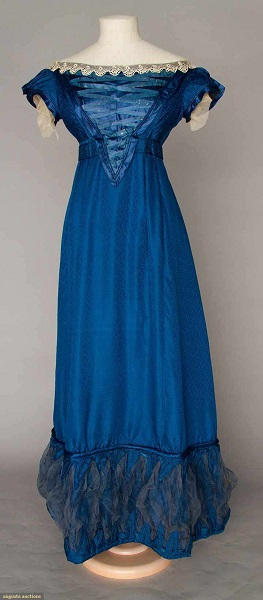 Augusta Auctions:COBALT SILK EVENING GOWN, 1820s Figured cobalt blue silk, empire bodice w/ laced V front satin panel, short cap sleeves, Lille lace trim, inset waist band, mesh puff hem trims. Front