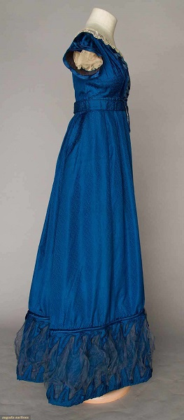 Augusta Auctions:COBALT SILK EVENING GOWN, 1820s Figured cobalt blue silk, empire bodice w/ laced V front satin panel, short cap sleeves, Lille lace trim, inset waist band, mesh puff hem trims. Right