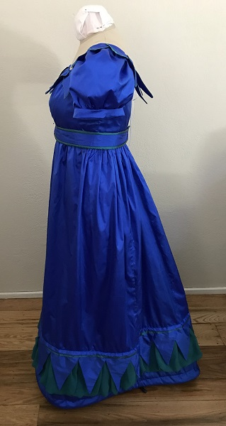 Reproduction 1820s Blue Dress with Van Dyke Points Left.