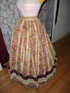 1860s reproduction striped evening dress skirt left three quarter view