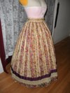 1860s reproduction striped evening dress skirt right three quarter view
