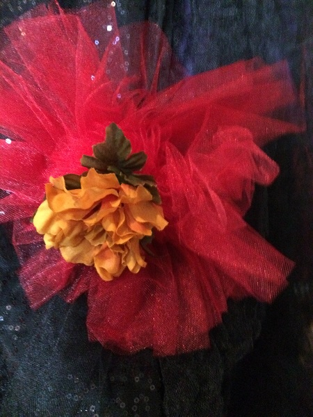 burgandy, red, black tulle with marigold flower pins