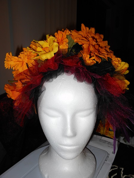 burgandy, red, black tulle with marigold flower headdress