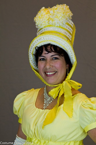 Reproduction Regency Yellow Dress and pom pom Hat. Photo by Andrew Schmidt.