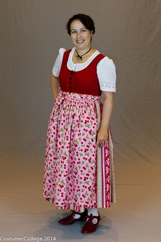 Red Dirndl with pink cherry apron. Photo by Andrew Schmidt.