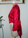 women's red and pink satin tailcoat left view