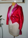 women's red and pink satin tailcoat left three quarter view
